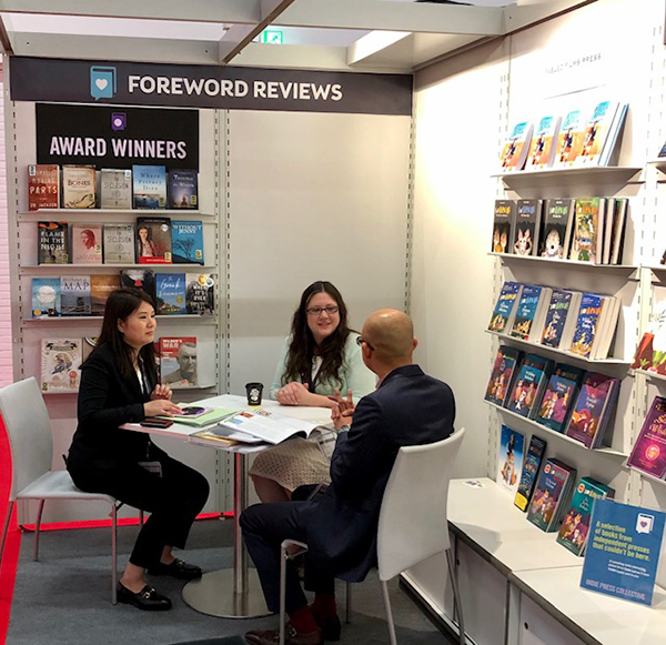 Guests at the Foreword Reviews Booth