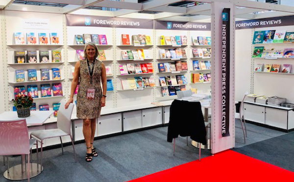Victoria Sutherland at Foreword Reviews booth